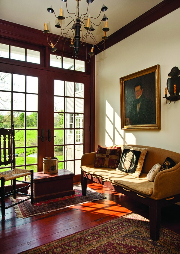 In the sun-drenched mud room, high-country antiques are paired with a circa 1820 portrait. - DEBORAH DEGRAFFENREID