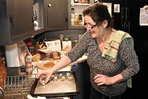 Jackie Rosenblatt baking cinnamon roll cookies at Audrey's Farmhouse Bed and Breakfast in Wallkill. - DAVID MORRIS CUNNINGHAM