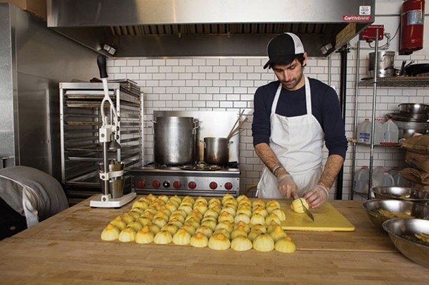 Jason Schuler cuts lemons that will provide freshly squeezed juice for his syrup. - KAREN PEARSON