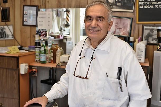 Joe Privitera at Joe's Barber Shop in Highland. - DAVID MORRIS CUNNINGHAM
