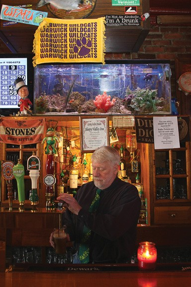 John Christison pours a pint of Guiness at his pub Yesterdays in Warwick. - ADAM FERNANDEZ