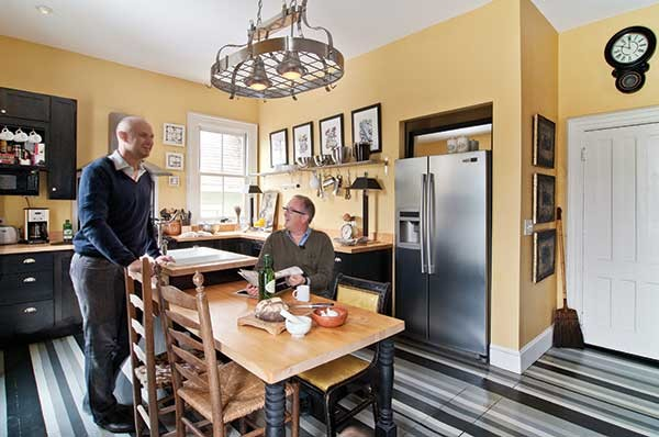 Juan Carretero and David Usborne in the kitchen of their historic Hudson home, Villa Sofia. - DEBORAH DEGRAFFENREID