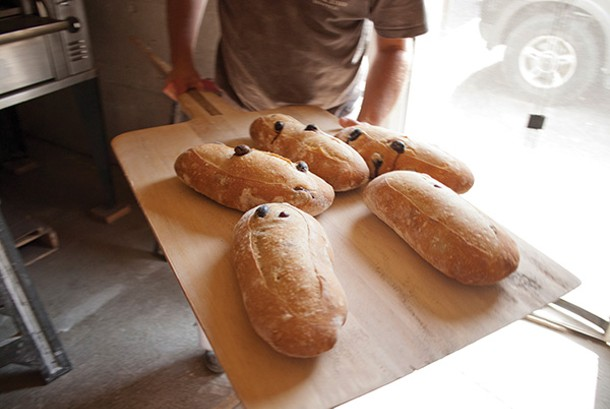 Kalamata olive bread at Bread & Bottle in Red Hook. - ROY GUMPEL
