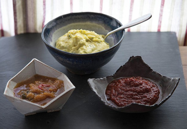 Ketchup, chive mayonnaise, and peach-basil chutney all made with homemade vinegar. Ceramics by the author. - PETER BARRETT