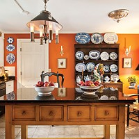 Kingston's First Mini-Mansion Kitchen: Welsh Dresser with collection of English Staffordshire, light fixture by designer David Anthony Easton, center island is an English potting Table. Paint color: Espresso. Deborah DeGraffenreid
