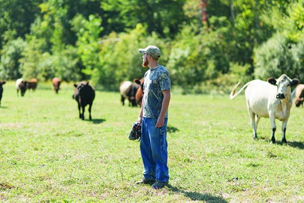 Kris Karl with his livestock at Karl Family Farms in Modena. - THOMAS SMITH
