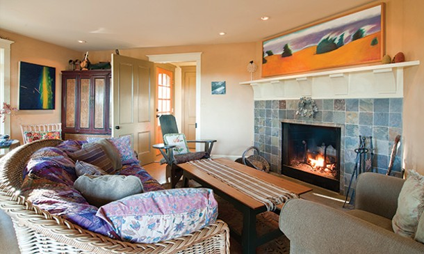 Living room with painting by Jerry Vis over the fireplace. - DEBORAH DEGRAFFENREID