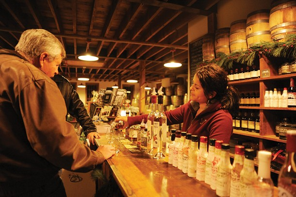 Luz Reid serves samples of locally microdistilled liquor at the Tuthilltown Spirits tasting room in Gardiner. - KELLY MERCHANT