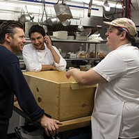The Prairie Whale Photos Mark Firth, sous chef Dan Studwell, and chef Stephen Browning over a wooden box containing freshly salted pig legs for prosciutto. Peter Barrett