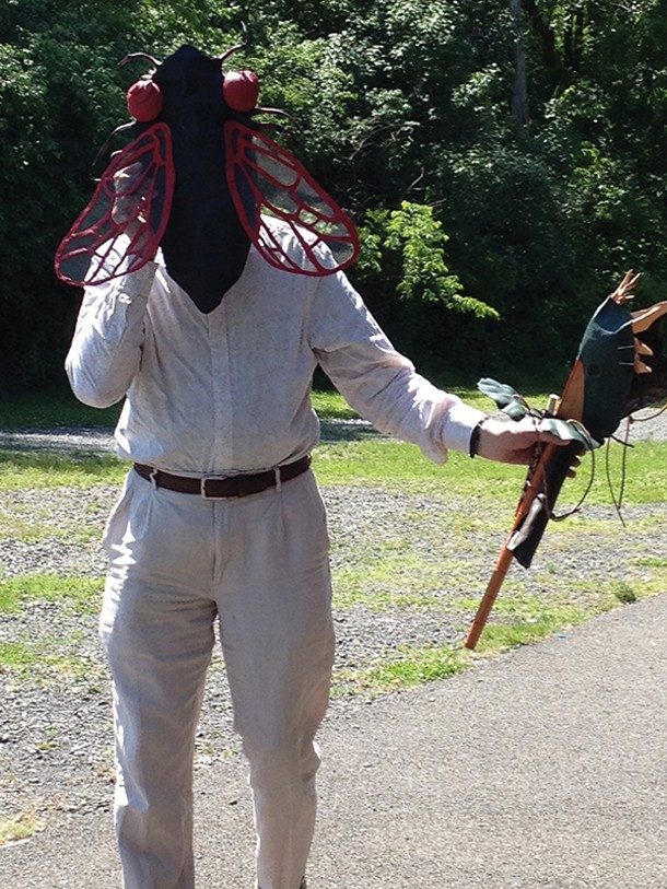 Mask-maker and composer Norman Lowrey at the 17-Year Cicada Celebration concert at Kingston's Rotary Park on June 15.