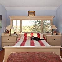 A Craftsman's Home in Rosendale Master bedroom with Sirius the cat. Deborah DeGraffenreid