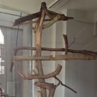 Bent Matt Bua, a Frame, hardwood debris, dimensions variable.