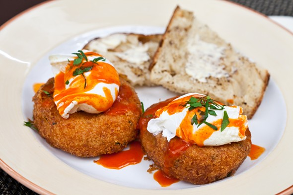Max London's brunch staple: homemade Salt Cod Potato Cakes topped with a poached egg, drizzled with house-made hot sauce and served with Mrs. London's organic rustic Italian toast. - VISUAL RECOLLECTION