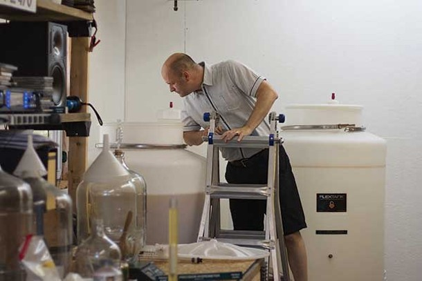 Meadmaker Peter Voelker checks the progress of fermentation in this year's mead.