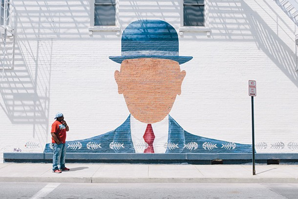 Monte Jones studies a mural on North Chestnut Street in Beacon. - THOMAS SMITH
