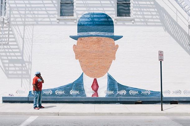 Monte Jones studies a mural on North Chestnut Street in Beacon. - THOMAS SMITH