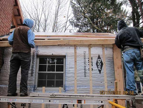 Mulder Construction workers perform a deep energy retrofit to a 65-year-old house in Rosendale, sponsored by a NYSERDA grant to Verdae LLC, as part of a workshop on  January 12. - MANNA JO GREENE