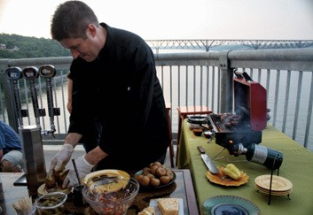 "Noah Sheetz, executive chef for New York's Governor's Mansion, grilling on the Mid-Hudson Bridge for an episode of ""Green Peas TV"" (www.greenpeastv.com). - ROB PENNER"