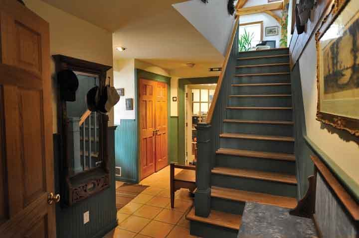 Opposite, below: Entry: the lower floor entry is decorated with wainscoating, door frames from the Manhattan loft building, doors from the Door Jamb on Rt. 28, antiques from local garage sales, and tiles from Nelson's in Saugerties. - PETER BRANDT
