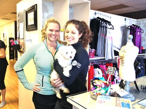 Owner Chelsea Streifenede and pilates instructor Tricia DeSario of Body Be Well Pilates in Red Hook & mascot