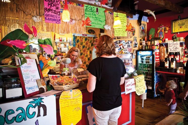 Pamela, the owner of Pamela's Java Hut in fishkill, serves a customer. - NATALIE KEYSSAR