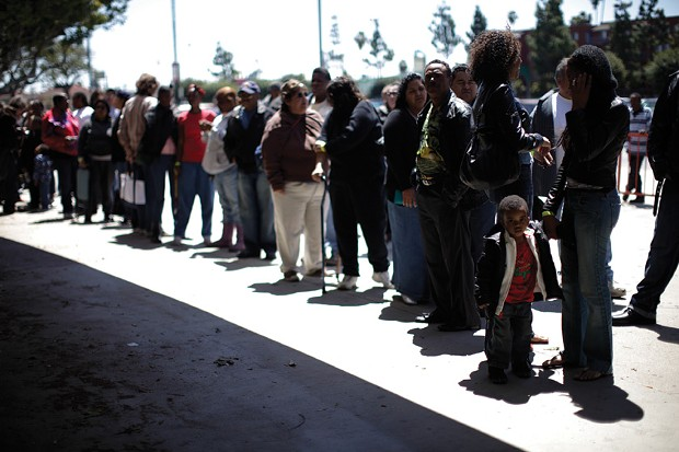 Patients wait for their wristband number to be called at the Remote Area Medical clinic in Los Angeles on April 28, 2010. Over seven days, doctors and dentists volunteering their services brought free medical, dental, and vision care to 7,000 uninsured and underinsured people in Los Angeles.