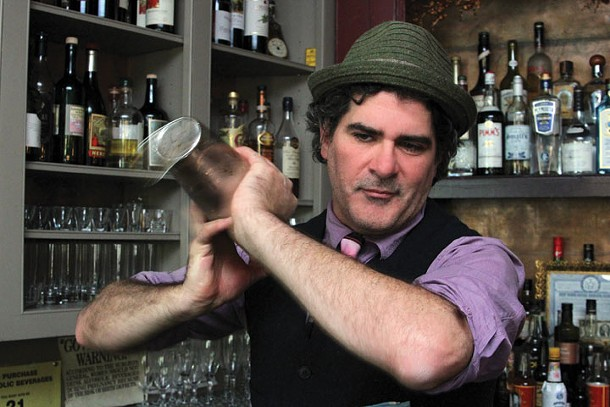 """Paul Maloney, owner/master mixologist at the Stockade Tavern, behind the bar. """"You can't be shy with the shaking,"""" says Maloney."""