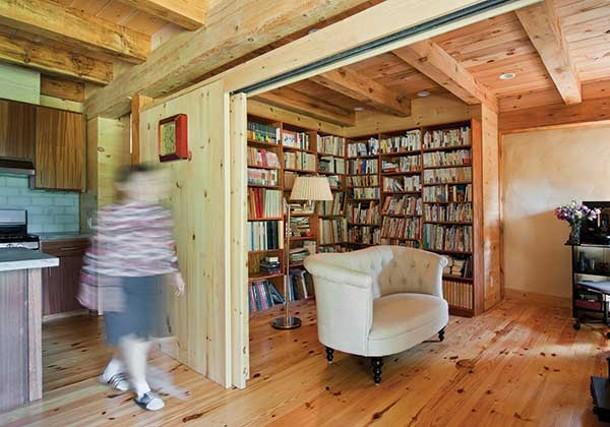 Preparing tea in the kitchen; custom-built bookshelves in the library.