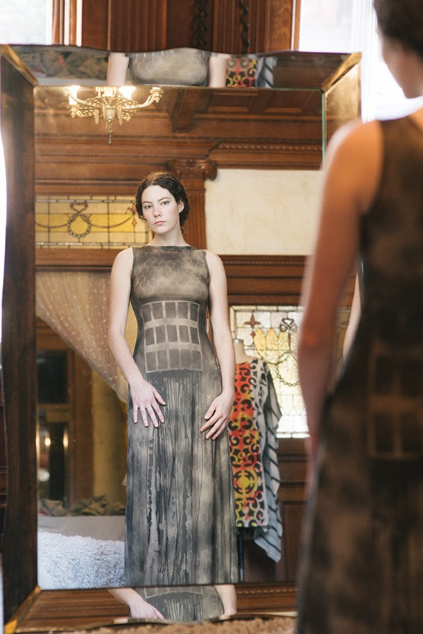 Rae Hatch tries on a dress at LALOON in Hudson. - THOMAS SMITH