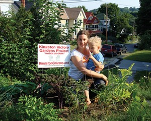 Rebecca Martin, Chair of the Garden Commitee of the Kingston Land Trust, with son Charlie Grenadier in one of three home gardens.