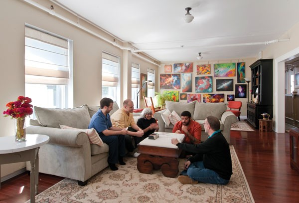 Rich Morris and Nora Strano in their light-filled living room with their three sons, who live at home. - DEBORAH DEGRAFFENREID