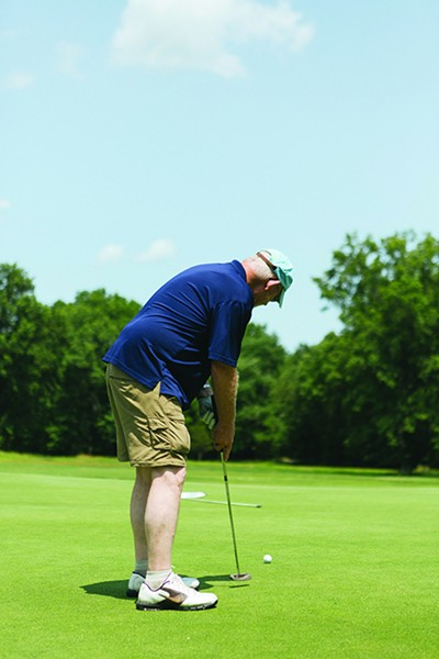 Russ Chapman putts for birdie on the New Paltz Public Golf Course. - THOMAS SMITH