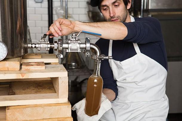 Schuler bottles his best-selling ginger ale syrup. - KAREN PEARSON