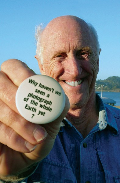 Stewart Brand with the button that launched a movement in Earth Days.