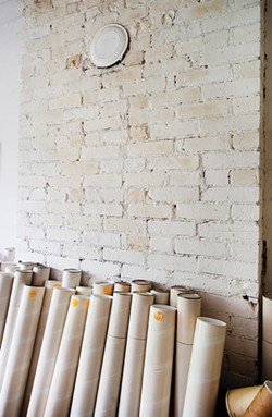 Storage tubes line the walls of Baer's third-floor architectural studio.