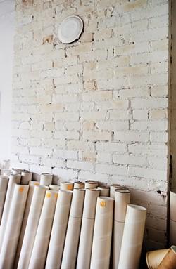 Storage tubes line the walls of Baer's third-floor architectural studio.