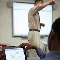 Technology In the Classroom Student uses his i-Pad to follow along with presentation synced from the classroom smart board. Courtesy of the Great Barrington Rudolf Steiner School