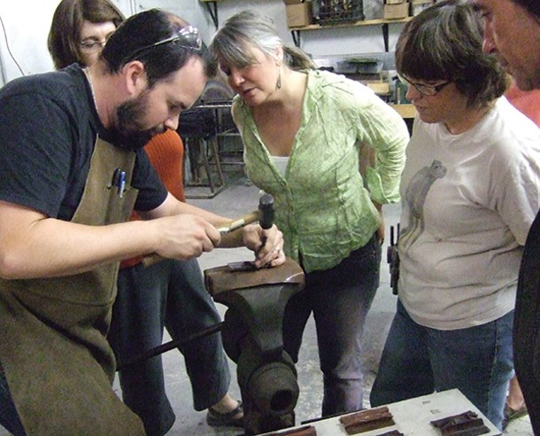 Students watch Darren Fisher's demonstration of a foldforming technique at the Center for Metal Arts in Florida.