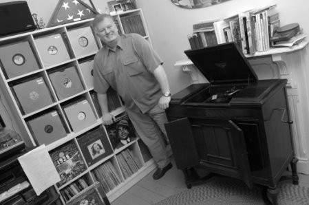 Sultan of Surface Noise: The DJ's living room is home to his Victrola and formidable record collection. - F-STOP FITZGERALD