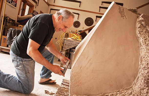 "The artist at work on one of the large clay sculptures that have become his signature. ""I like the combination of working with my brain and my hands,"" Chaleff says. - A conical clay piece inspired by a rock-drill bit. In the 1990s, Chaleff added a wood-fired kiln to the open-air studio built by Sir Anthony Caro in the 1980s - DEBORAH DEGRAFFENREID"