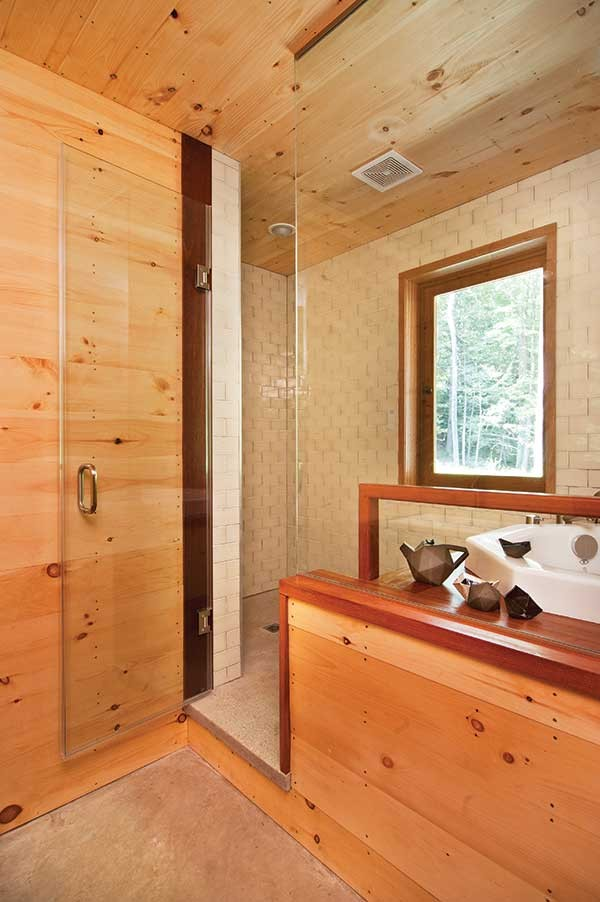 The bathroom features a Japanese-style deep soaking tub. Ceramics by Peter Barrett.