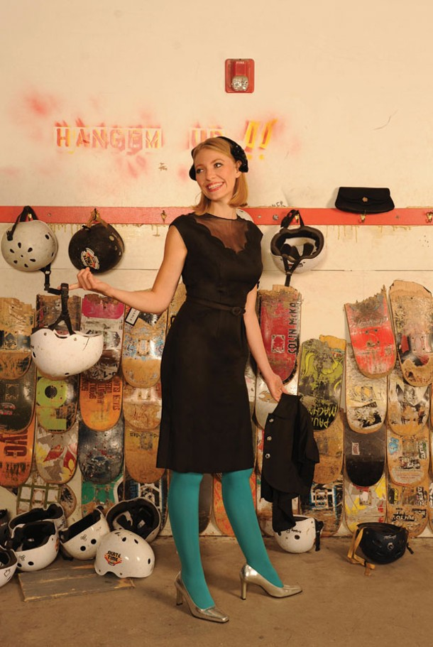 The Belle of the Skate Park: Cassandra Hansen wearing a Herbert Sondheim 1950s black dress with a sheer scalloped yoke and a Gilbert Orcel 1950s velvet band hat trimmed with black sequins. She is holding a matching short jacket with rhinestone buttons. 1950s/1960s black satin clutch. Make up by Saadah Garbey. From Vintage Studio. - KELLY MERCHANT