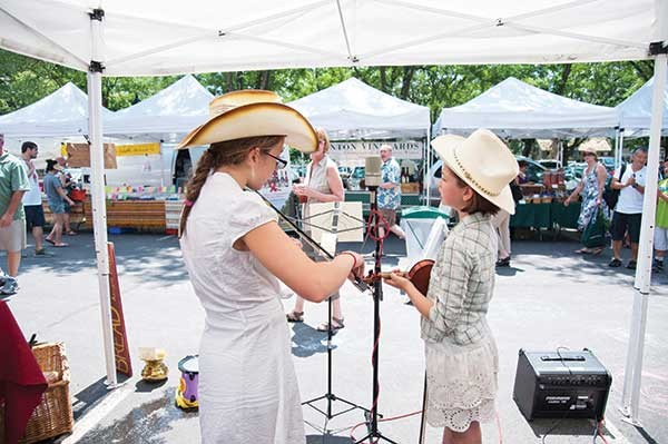 The Cow Gals performing at the Rhinebeck Farmers Market. - ROY GUMPEL
