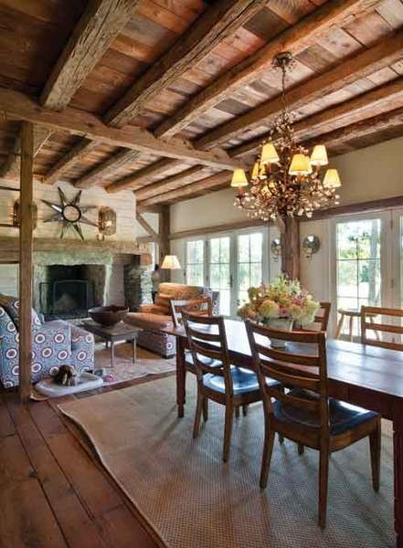 The dining room/living room with a two-sided fireplace. - DEBORAH DEGRAFFENREID