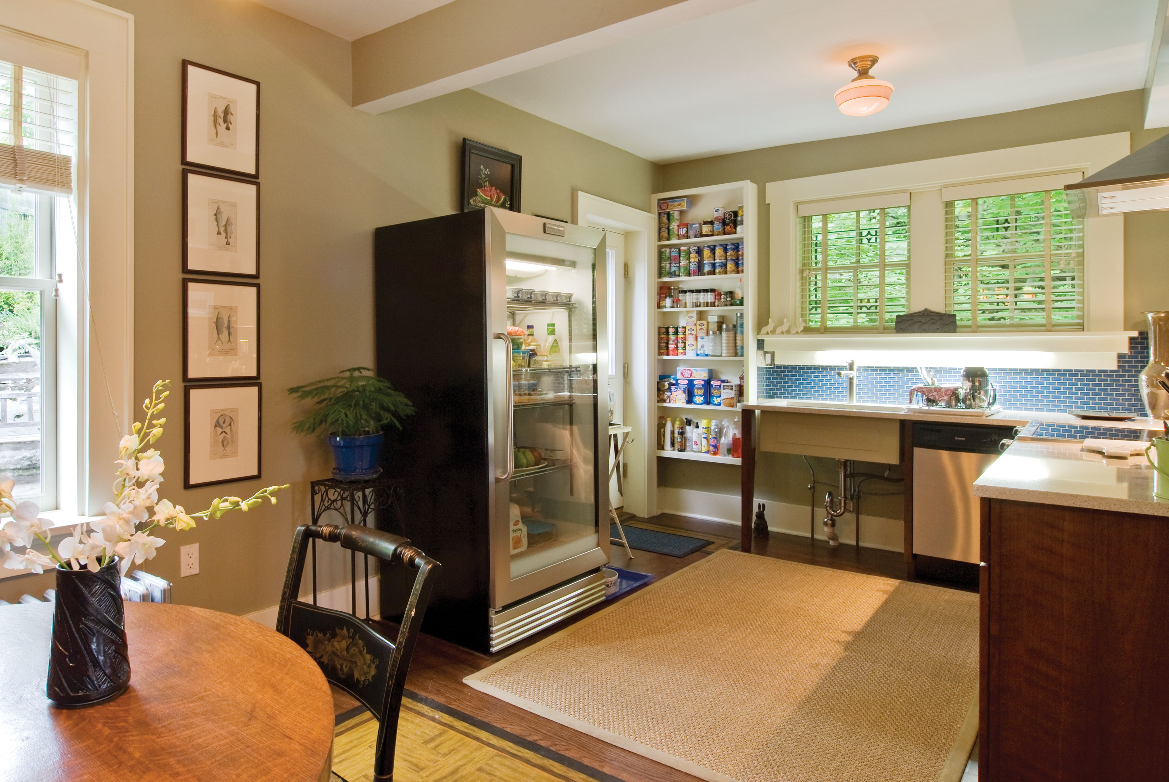 The eat-in kitchen is used to maximum efficiency with a minimum of storage space and stainless-steel appliances. - DEBORAH DEGRAFFENREID