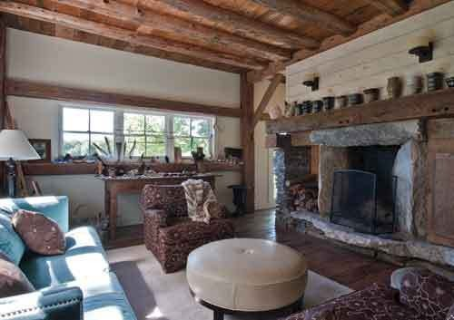 The family room where pottery by friends and family members lines the mantel. - DEBORAH DEGRAFFENREID