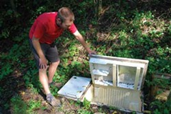 The Hudson Valley Seed Library's Doug Muller experiments with storing produce in a sunken refrigerator. - LARRY DECKER