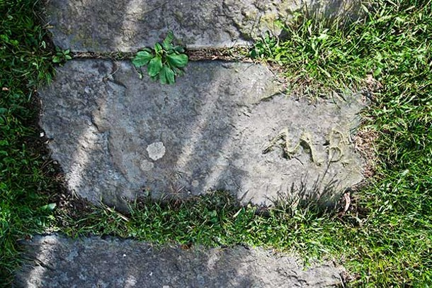 The initials of Matthew Bambrick, who resided in the home in the early 1900s.