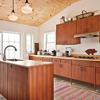 Jeffrey Adkisson's Stockport Salvage The kitchen features 1960s handbuilt walnut plywood cabinets with teak handles