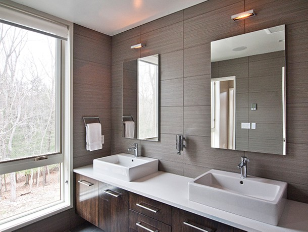 The master bath's simplicity is accented by the ceramic tile walls.